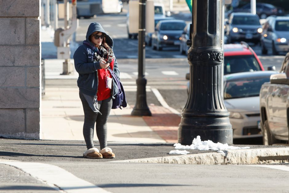 Kelly Robinson of Meriden waits to cross Colony Street Wednesday in Meriden December 27, 2017 | Justin Weekes / Special to the Record-Journal