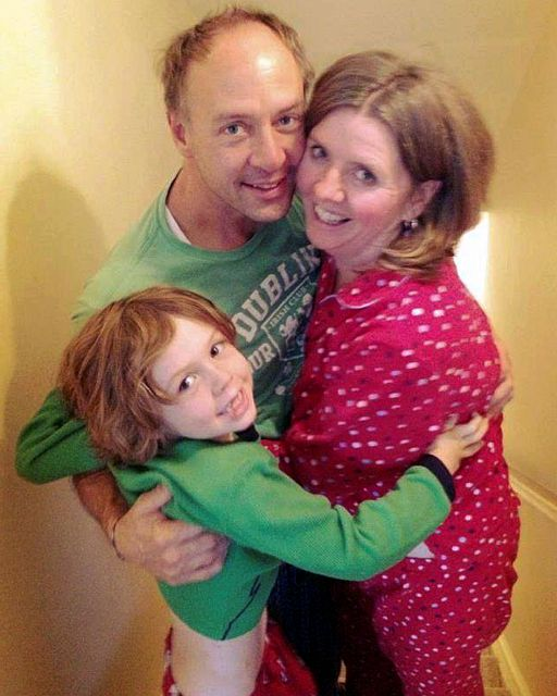 This undated family photo provided by Sandy Hook Promise shows Mark Barden, center, with his son Daniel, left, and wife Jacqueline. Daniel was among those killed in the Sandy Hook Elementary School shooting on Dec. 14, 2012 in Newtown, Conn. The Barden parents were co-founders of Sandy Hook Promise, a group that lobbied for mental health care changes and gun control legislation in the months after the shooting. (Mark Barden/Sandy Hook Promise via AP)