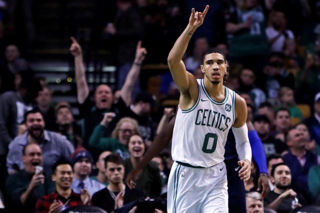 Boston Celtics forward Jayson Tatum (0) celebrates after a basket during the second half of an NBA basketball game against the Dallas Mavericks in Boston, Wednesday, Dec. 6, 2017. The Celtics defeated the Mavericks 97-90. (AP Photo/Charles Krupa)