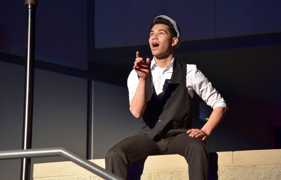 "Junior Josh Medina practices his role ""Burt"" while preparing for the school's spring musical ""Mary Poppins,"" on Monday."