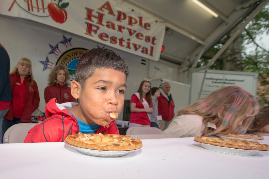 Edwin Castillo 8 of Waterbury finished third in the pie eating contest Saturday during the 49th Apple Harvest Festival in Southington September 30, 2017 | Justin Weekes / For the Record-Journal