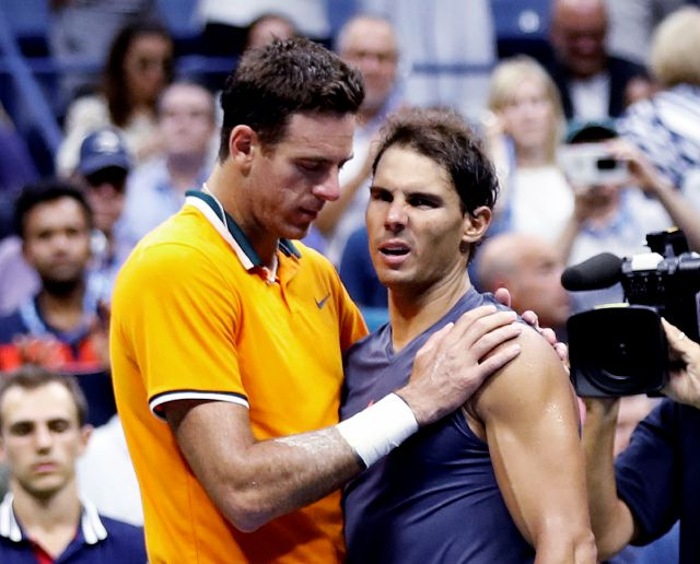 Juan Martin del Potro, of Argentina, talks with Rafael Nadal, of Spain, after Nadal retired from the match during the semifinals of the U.S. Open tennis tournament, Friday, Sept. 7, 2018, in New York. (AP Photo/Adam Hunger)