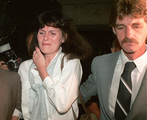 ** ADVANCE FOR MONDAY, MAY 10 ** Mary Beth Whitehead and her husband, Richard, leave the courthouse in Hackensack, N.J., Sept. 10, 1986. Whitehead acted as a paid-surrogate mother for William and Betsy Stern but then refused to give up custody of the baby girl. The New Jersey Supreme Court ultimately gave the Sterns custody in what was called the Baby M case, but also gave Whitehead visitation rights; while also making surrogate parenting in exchange for money illegal. (AP Photo/Mike Derer, file)