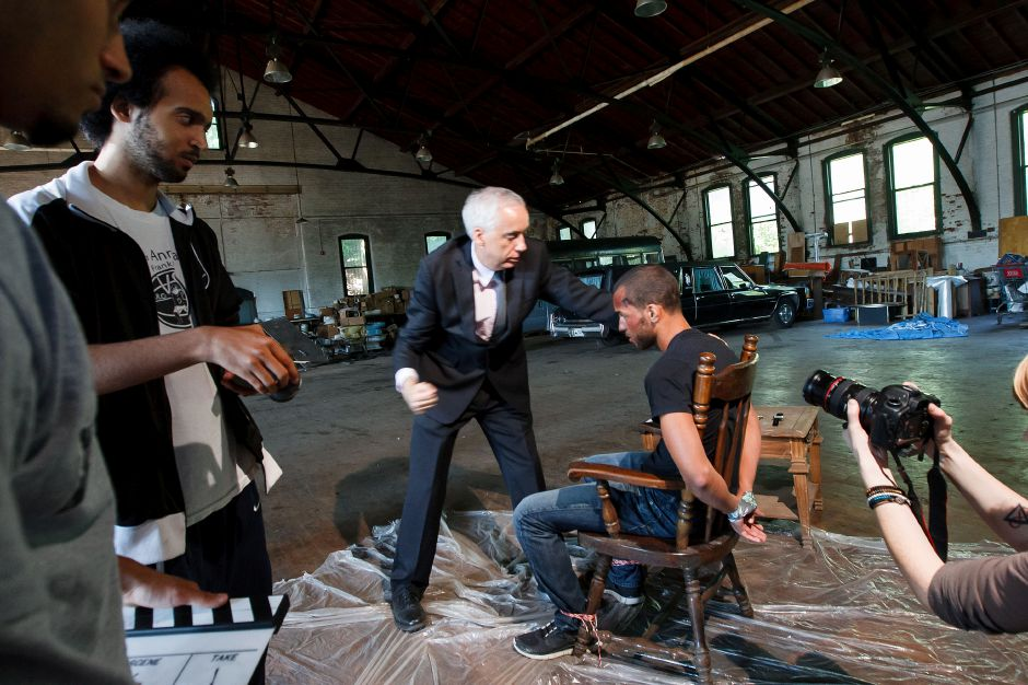 "Actors Robert Condon of Milford, left, as ""Sebastian the Mob Boss"" and Lance Williams of West Hartford, right, as ""Stephen Nash"" rehearse a scene in a short movie being filmed in the former armory Saturday morning in Meriden, July 27, 2013. 