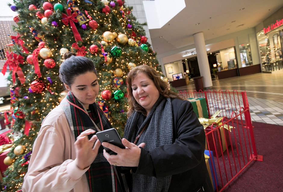 Amanda Martinez, left, and mother Mayra, of St. Cloud, FL, set up for a selfie in front of a Christmas tree at Westfield Meriden mall, Tuesday, Nov. 14, 2017. | Dave Zajac, Record-Journal