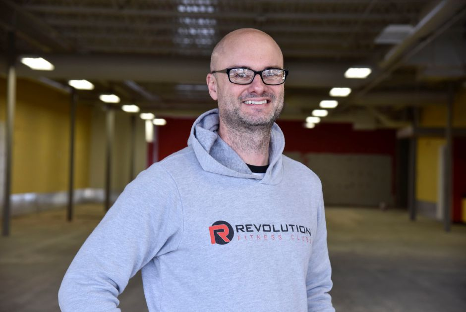 Jason Perrone, creator and CEO of Revolution Fitness Clubs, poses inside the health club on Jan. 2. He expects to open mid-February at 87 Washington Ave. in North Haven. | Bailey Wright, Record-Journal