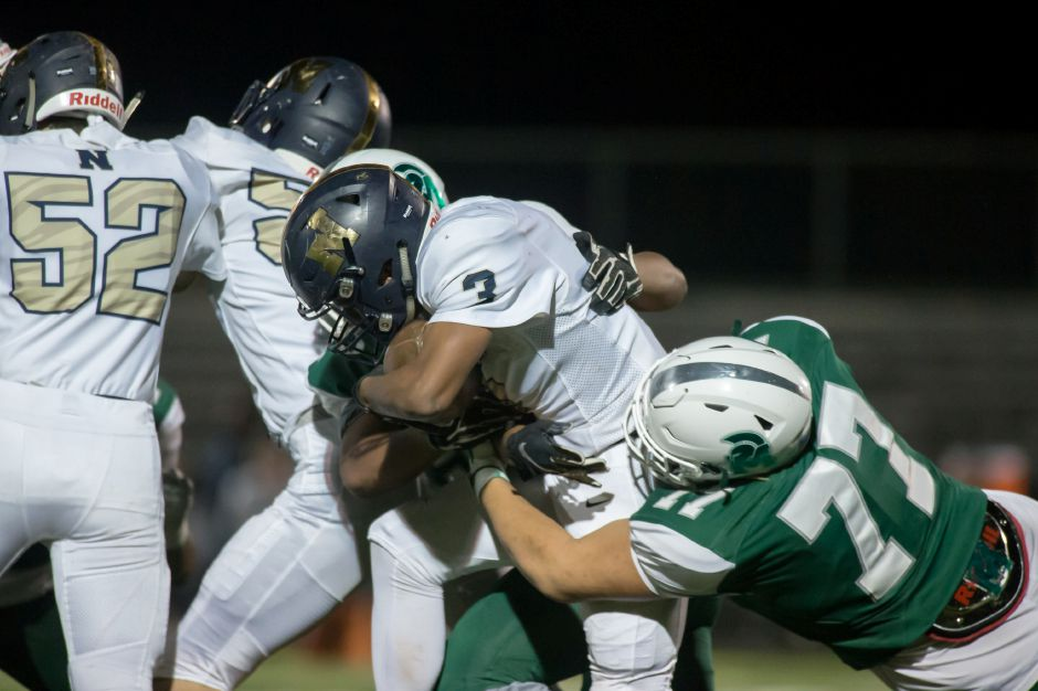 Maloney lineman Trevor Santiago blocked a punt and recovered a fumble in Friday night's 30-22 victory over Windsor at Falcon Field, a win that clinched a third straight Class L playoff berth for the Spartans. | Justin Weekes / Special to the Record-Journal