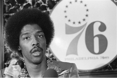 Julius Erving answers questions during a news conference Oct. 22, 1976 in Philadelphia following the announcement that he signed a 6-year contract with the Philadelphia 76ers. Erving will be payed 3.5 million for the six years. (AP Photo)