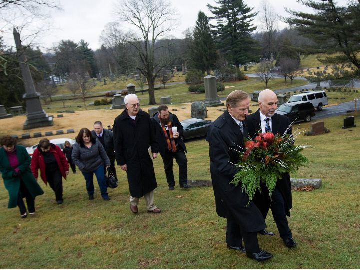 "Retired Police Chief Robert E. Kosienski and Keith McCurdy, a Detective Sargent in 1988, carry a wreath to the grave of infant David Paul during an annual memorial service at Walnut Grove Cemetery in Meriden, Wednesday, January 4, 2017. The 1-day-old boy, was found frozen to death at the base of a tree in a South Meriden parking lot on Jan. 2, 1988. The police department adopted the child and gave him the name David Paul, which means ""God's beloved little man"" in scripture. The mother was never found and the case remains open. 