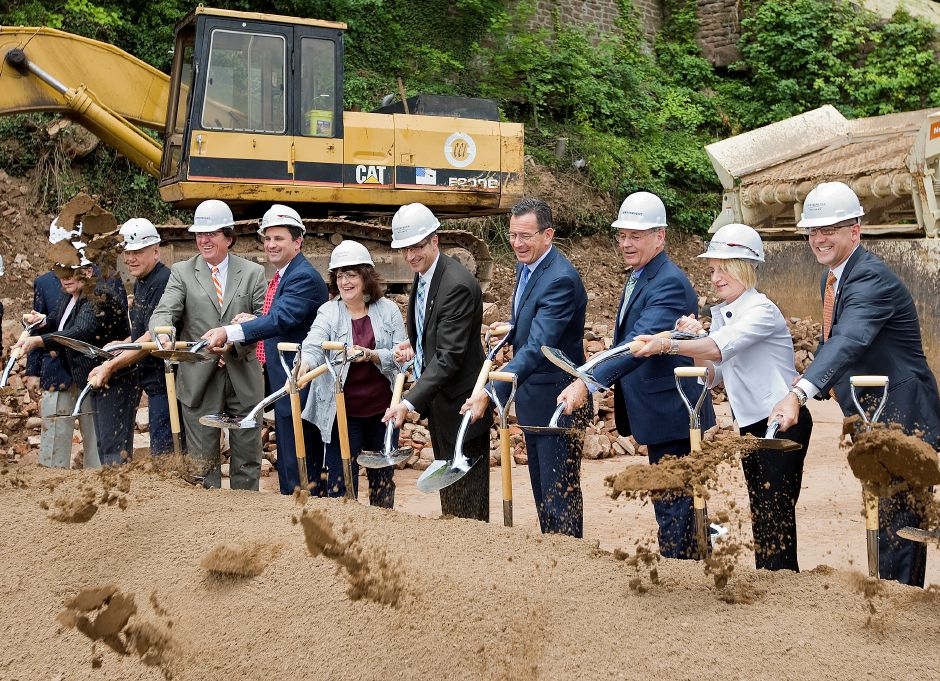Gov. Dannel P. Malloy and Mayor Manny Santos take center stage among several local and state officials during a ceremonial groundbreaking for a new mixed-use building at 24 Colony St. in Meriden, Wednesday, July 8, 2015. The project will include 63 apartments and more than 11,000 square feet of commercial and retail space, as well as a 275-space parking garage. | Dave Zajac / Record-Journal