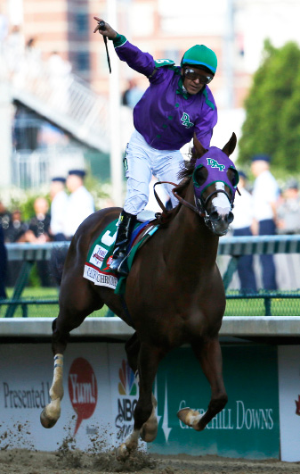 Victor Espinoza rides California Chrome to victory during the 140th running of the Kentucky Derby.  | AP Photo/Tim Donnelly