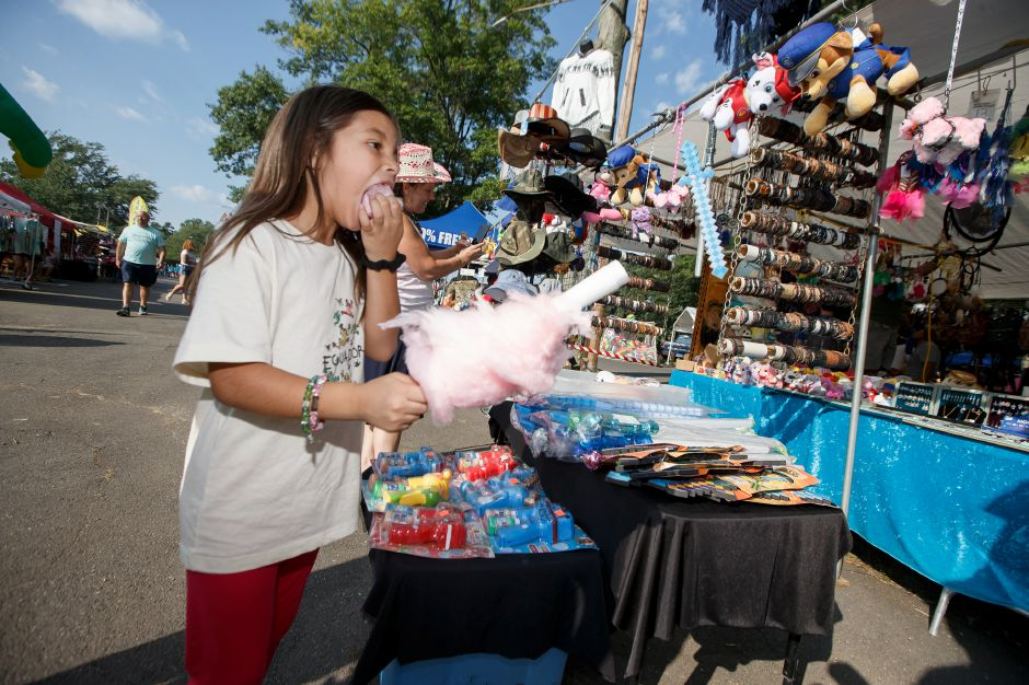 Lily Lopez-Casteel 6 of Cornwall munches on cotton candy Friday during the 34th Annual Plainville Balloon Festival at Norton Park in Plainville August 24, 2018 | Justin Weekes / Special to the Record-Journal
