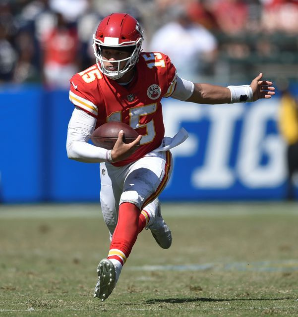 FILE - In this Sept. 9, 2018, file photo, Kansas City Chiefs quarterback Patrick Mahomes runs against the Los Angeles Chargers during the second half of an NFL football game, in Carson, Calif. The Indianapolis Colts play the Chiefs in a divisional playoff game on Saturday, Jan. 12, 2019.(AP Photo/Kelvin Kuo, File)