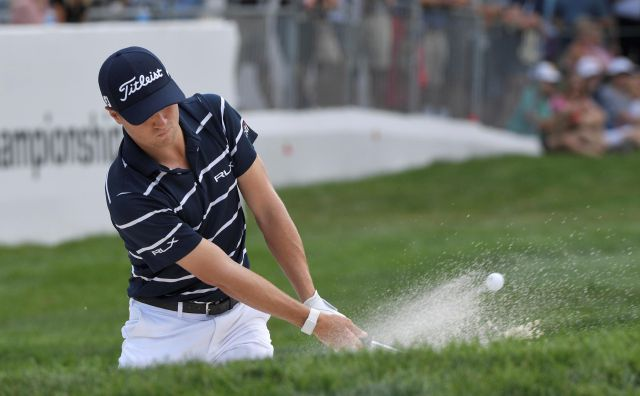 Justin Thomas hits from the bunker  during the first round of the BMW Championship golf tournament at Medinah Country Club Thursday. Associated Press