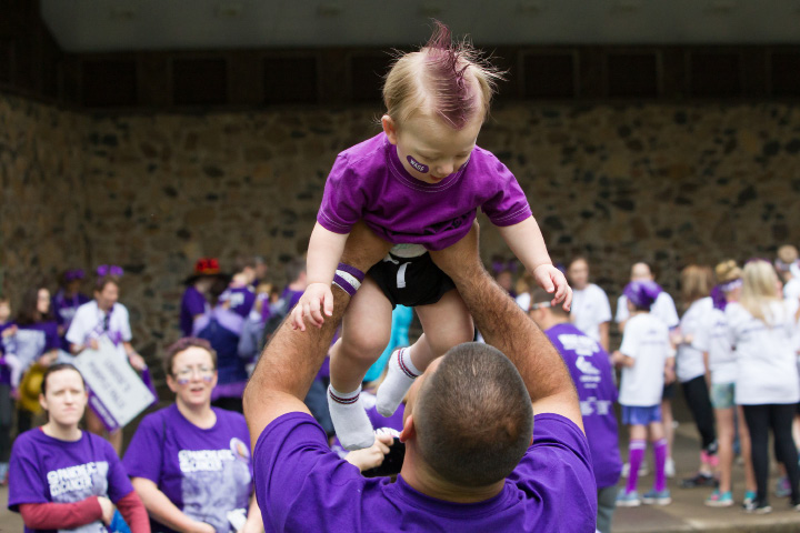 Dave Dufour tosses his son Mason 11m of Waterbury as the wait for the walk to start Saturday during the PurpleStride 5k and walk fundraiser for Pancreatic Cancer Action Network at Hubbard Park in Meriden Jun. 17, 2017 | Justin Weekes / For the Record-Journal