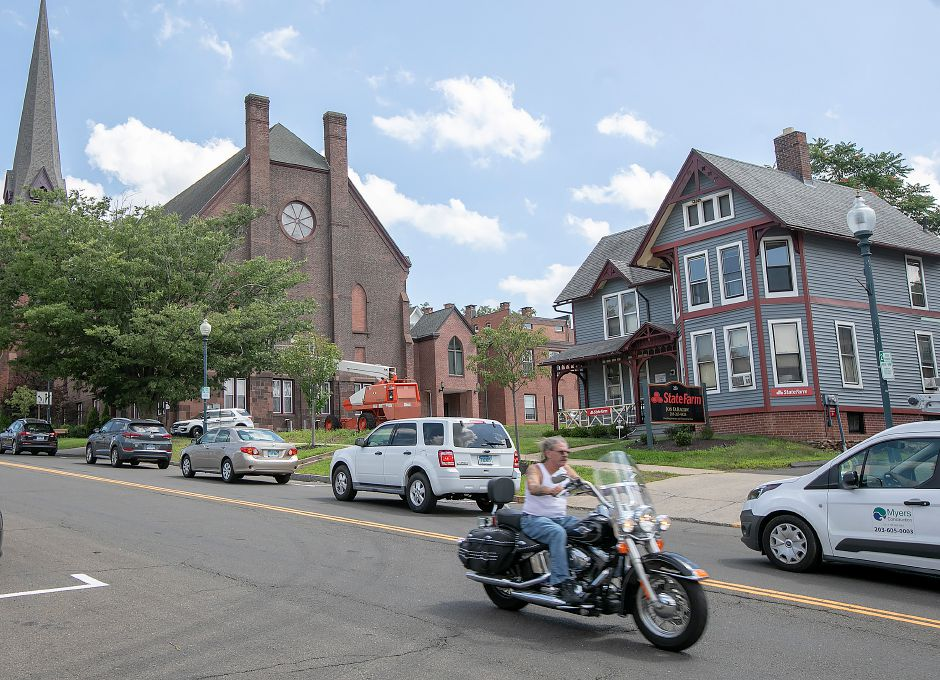 Motorists travel on Center Street in Wallingford, Thursday, August 2, 2018. The Planning and Zoning Commission is considering regulations that would create a new downtown zone to stimulate economic activity in the area. Dave Zajac, Record-Journal