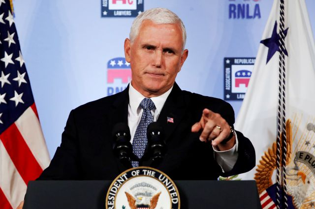FILE - In this Aug. 24, 2018 file photo, Vice President Mike Pence gestures while speaking to the Republican National Lawyers Association in Washington. President Donald Trump is lashing out against the anonymous senior official who wrote an opinion piece in The New York Times. Washington is consumed by a wild guessing game as to the identity of the writer, and swift denials of involvement in the op-ed came Thursday from top administration officials, including from Vice President Mike...