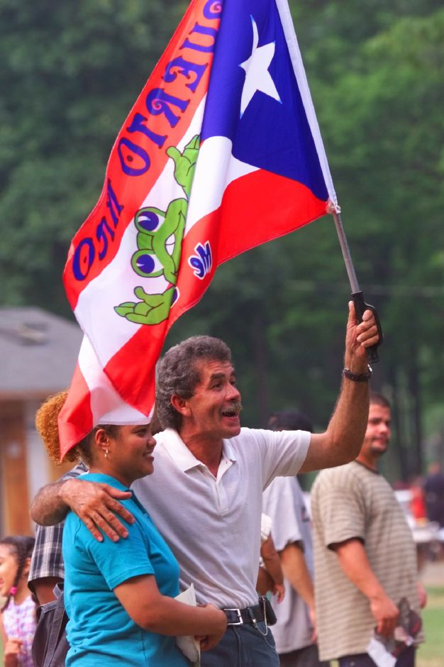 Efrain Pabon and wife Lydia Hernandez of New Britain show their national pride during the Puerto Rico Festival at Hubbard Park on Sunday July 18, 1999.