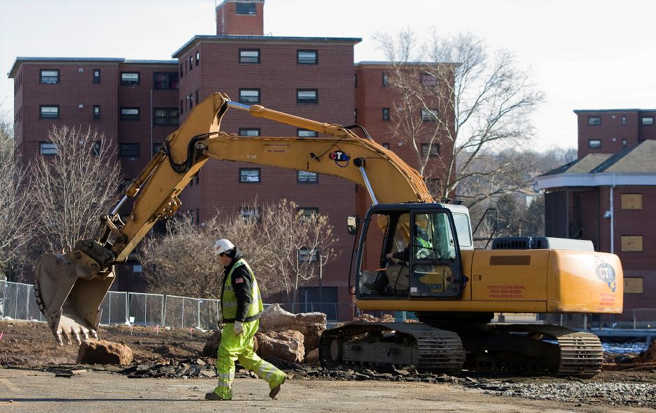 Soil cleanup has begun on the corner of Mill and State streets in Meriden, where a new mixed-income apartment building is planned for what is now a parking lot, Monday, January 16, 2017. | Dave Zajac, Record-Journal