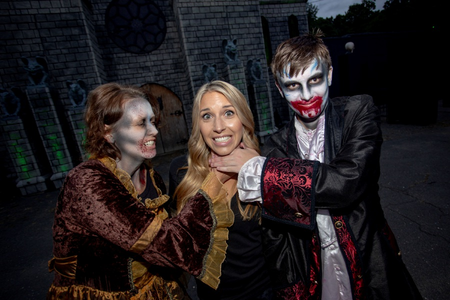 Makeup artist Christina Klanchich, center, and two of her creations, Kathy Hall, left, and Ethan Hall, pose at the Haunted Graveyard at Lake Compounce.