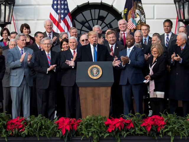 FILE - In this Dec. 20, 2017, file photo, President Donald Trump speaks during an event on the South Lawn of the White House in Washington, to acknowledge the final passage of tax overhaul legislation by Congress. In his first two years in office, Trump has rewritten the rules of the presidency and the norms of the nation's capital, casting aside codes of conduct and traditions that have held for generations. (AP Photo/Carolyn Kaster)