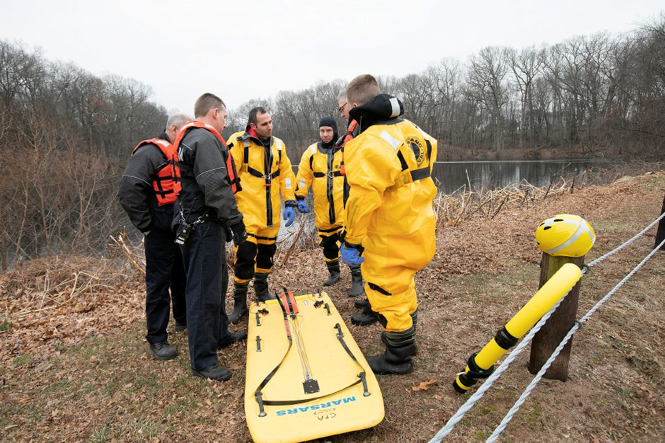 Southington firefighters prepare for a cold water rescue exercise at a pond off Mandel Drive in Southington, Wed., Jan. 16, 2019. Dave Zajac, Record-Journal