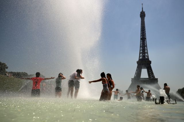 Youngsters cool off at the Trocadero public fountain in Paris, Wednesday, June 26, 2019. High temperatures are expected to go up to 39 degrees Celsius (102 Fahrenheit) in the Paris area later this week and bake much of the country, from the Pyrenees in the southwest to the German border in the northeast. (AP Photo/Francisco Seco)