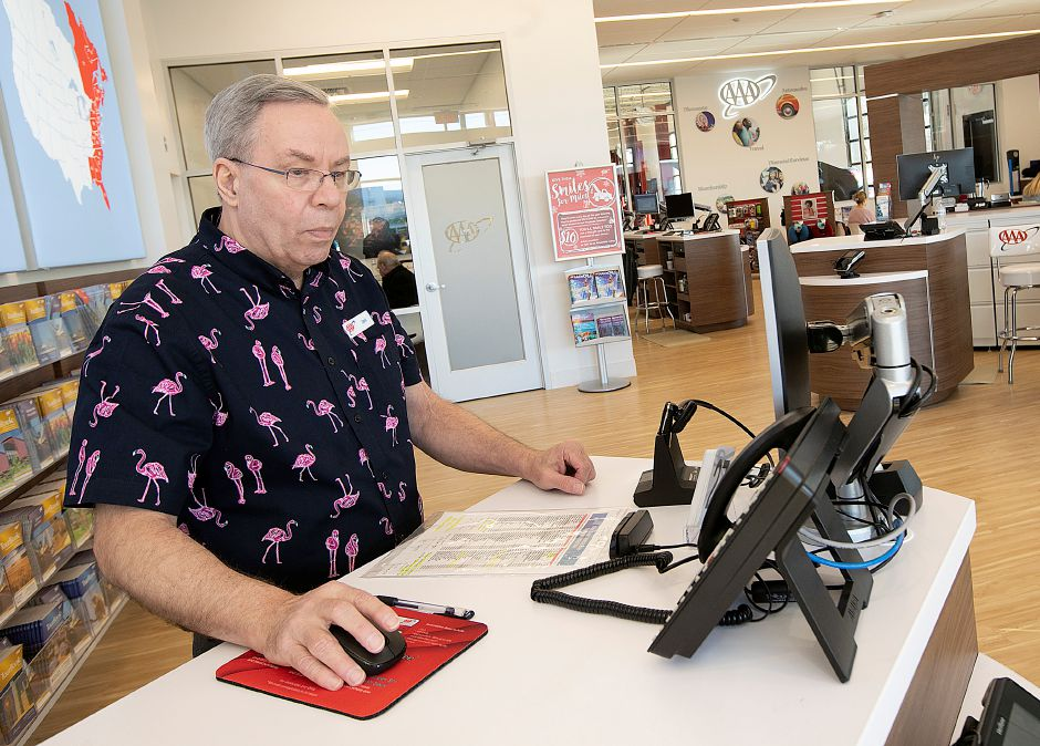 David Kaine, auto service associate 2, works at his desk at the new AAA travel center, DMV express and car care building on Queen Street in Southington, Wednesday., Dec. 19, 2018. Dave Zajac, Record-Journal