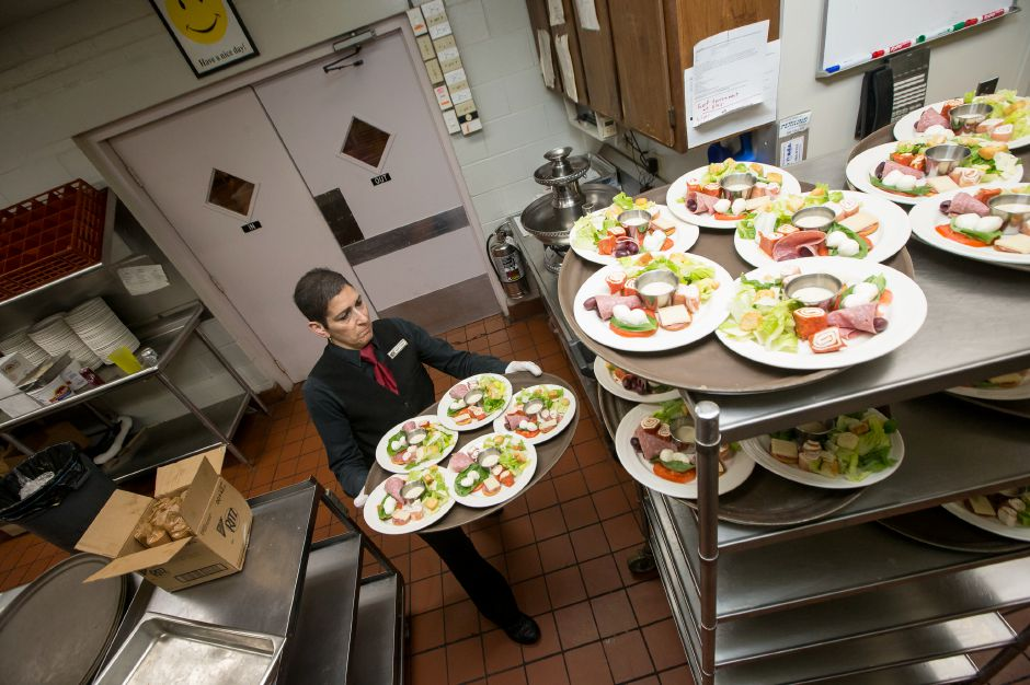 Maryann Huntington, of Middletown, stacks plates of salad.