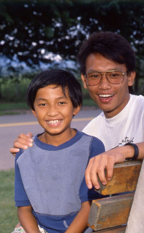 RJ file photo - Khang Pham, 12, and Khanh Pham, 16, are carving out a new life in Meriden after fleeing Vietnam 9 years ago, Aug. 1989.