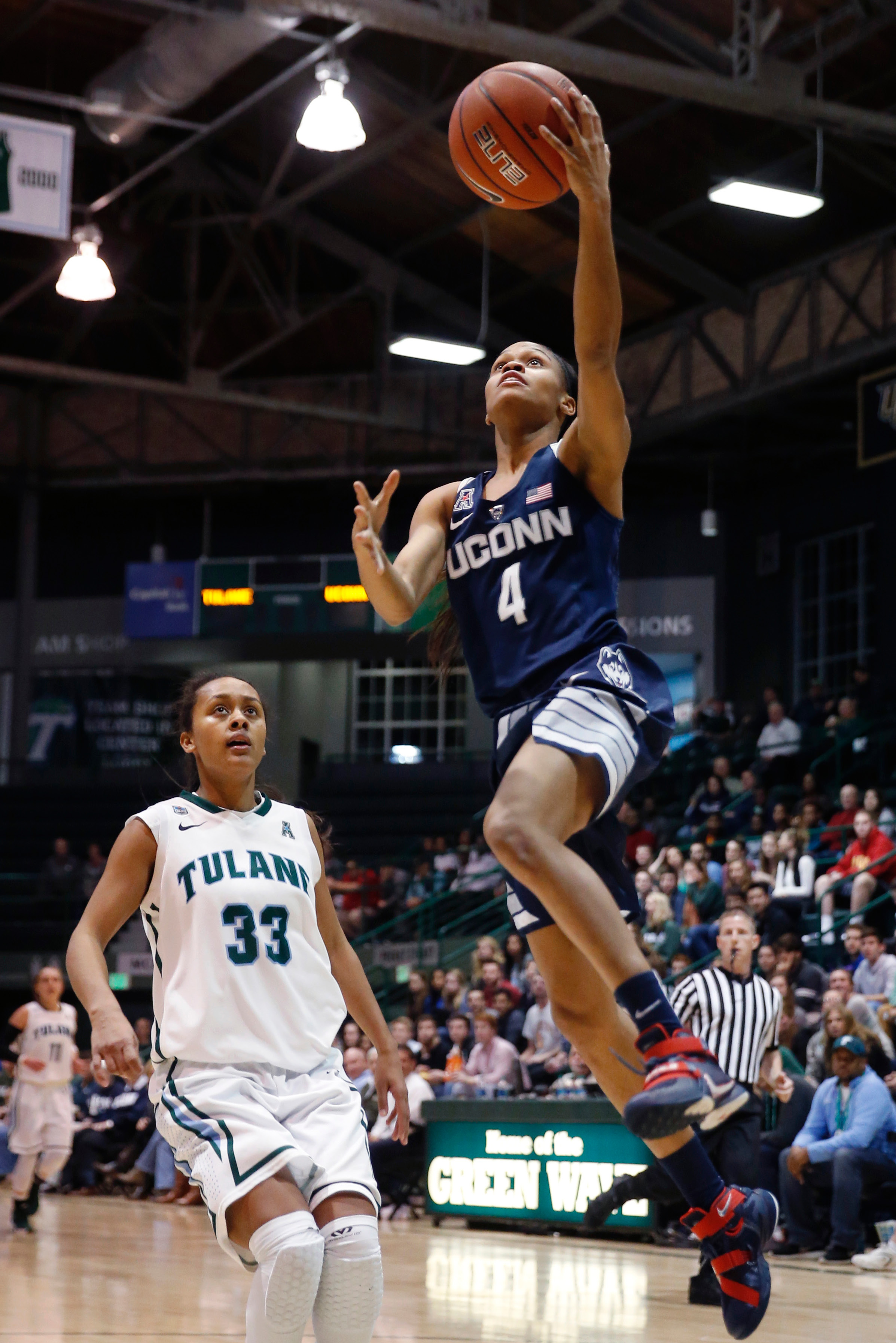 15d4ef9dfe9c Connecticut guard Moriah Jefferson (4) goes to the basket against Tulane  guard Courtnie Latham
