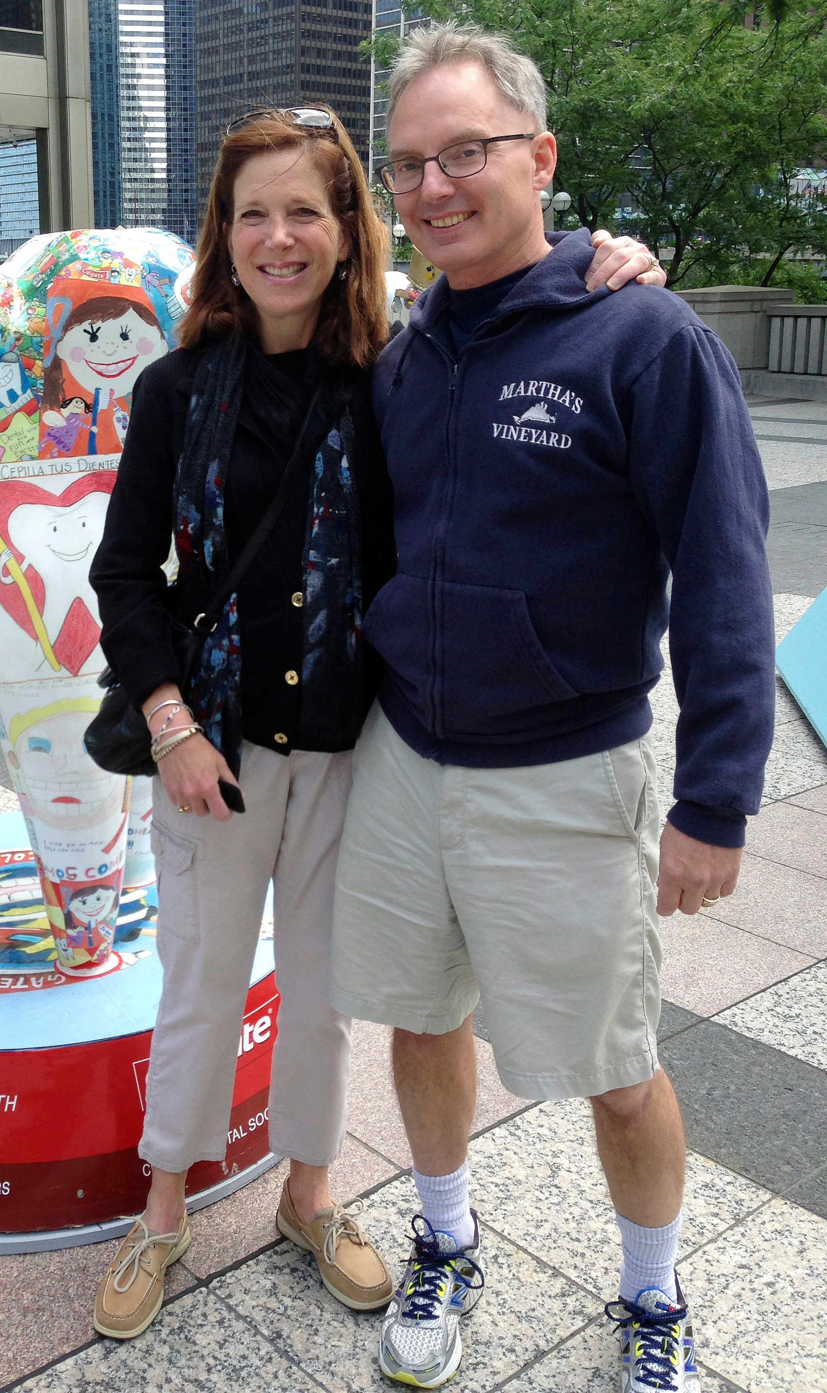 In this July 2014 photo provided by Karen Friend, Friend, left, stands with her husband, Jacob Vinton, on Michigan Avenue in Chicago. Friend, a professor at Brown University in Providence, R.I., took four weeks off in 2014 after her 59-year-old husband, who has early-onset Alzheimers disease, was hospitalized with tremors. She used the time to make sure he was medically stable and hire help. (Courtesy of Karen Friend via AP)