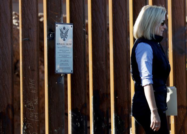 U.S. Department of Homeland Security Secretary Kirstjen Nielsen walks away from a plaque adorning a newly fortified border wall structure Friday, Oct. 26, 2018, in Calexico, Calif. (AP Photo/Gregory Bull)