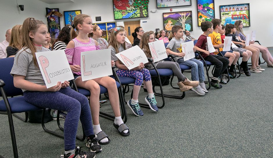Plantsville School students spell out the name of their school during a meeting on renaming Plantsville School and South End School at the John Weichsel Municipal Center in Southington, Tues., May 21, 2019. Dave Zajac, Record-Journal