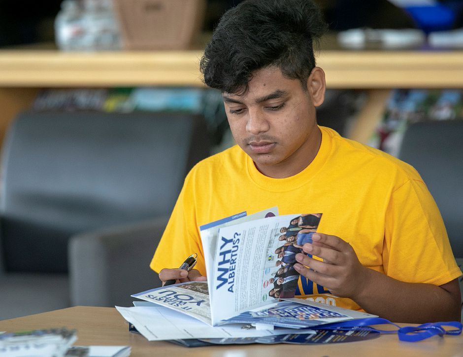 Platt student Refat Hossain, 18, looks over materials from Albertus Magnus College during a college prep round table at Platt High School, Wed., Aug. 14, 2019. Dave Zajac, Record-Journal