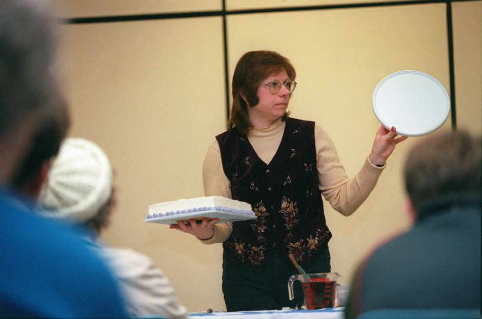 RJ file photo - Alexis Burgess, an award-winning baker, shows off the tools of her trade during her cake decorating demonstration at the Meriden Public Library Jan. 24, 1999.