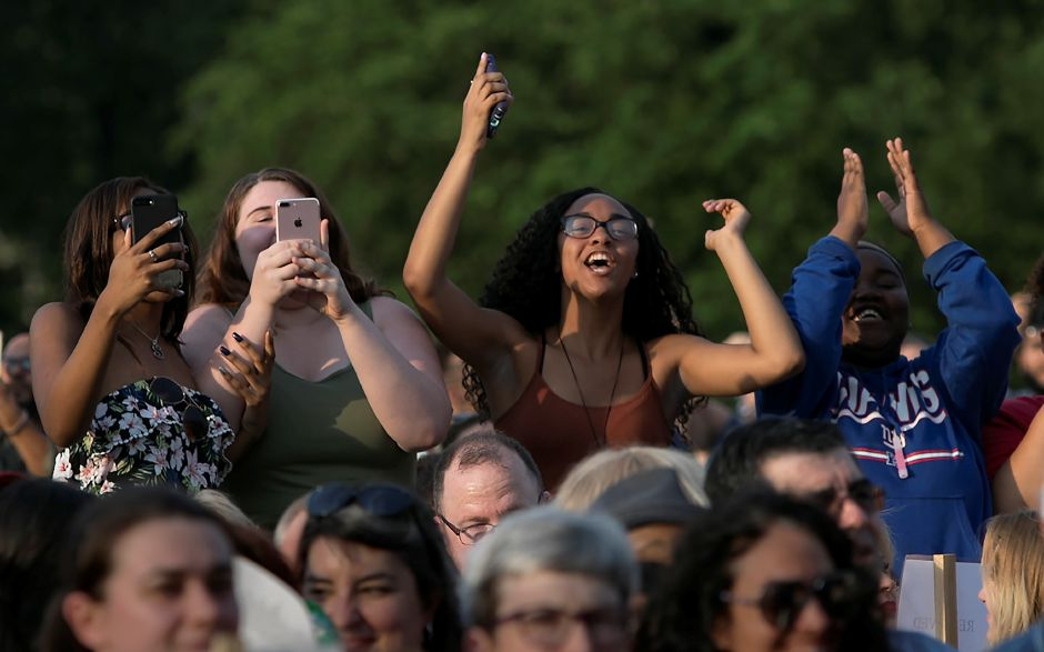 Family members cheer on a graduate during graduation ceremonies at Maloney High School in Meriden, Tuesday, June 13, 2017. | Dave Zajac, Record-Journal