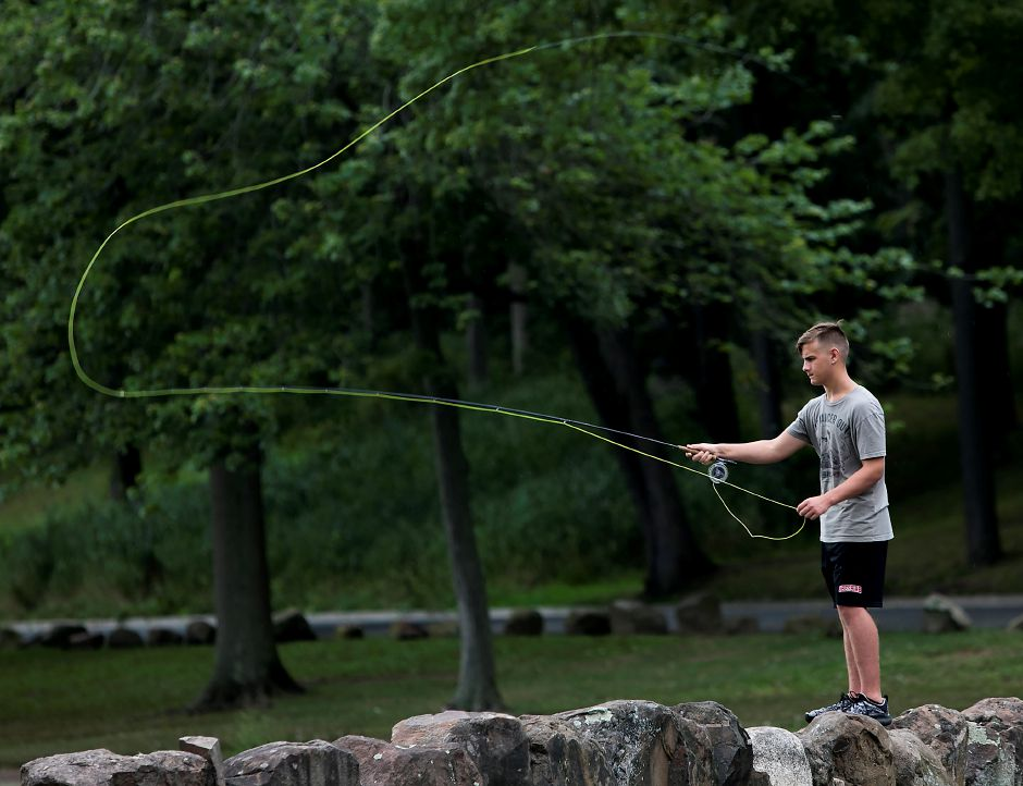 Jack Villano, 15, of Cheshire, casts a line into Mirror Lake while fly-fishing at Hubbard Park in Meriden on Aug. 18.