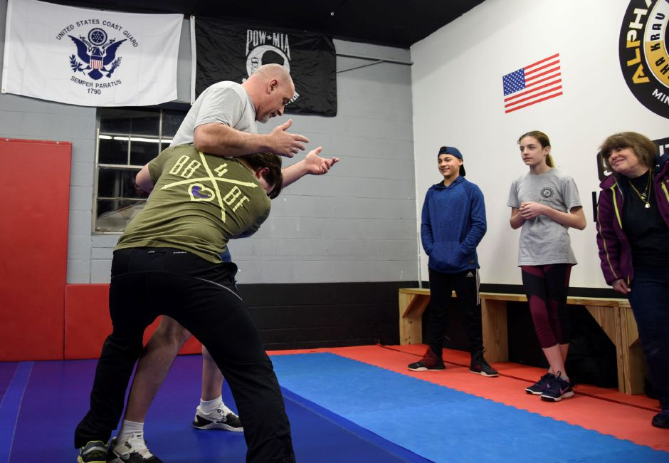 "Participants group up to practice tackles while learning techniques for the ""fight"" portion of staying safe in an active shooter senario, at Krav Maga Southington in Plantsville Friday, Feb. 23. 