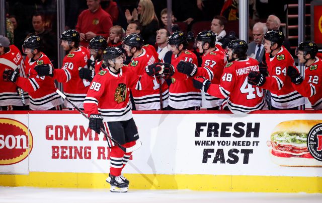 Chicago Blackhawks right wing Patrick Kane (88) celebrates with teammates after scoring against the New York Islanders during the first period of an NHL hockey game Saturday, Jan. 20, 2018, in Chicago. (AP Photo/Kamil Krzaczynski)