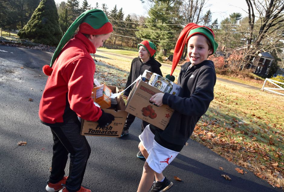Clayton Wiseman, 12, helps Eli Wiseman, 10, carry boxes full of donations during the 13th annual Community Round-up in Durham and Middlefield on Saturday, Dec. 1, 2018. The event collected more than 13,000 food items and about $3,500 to go to Durham and Middlefield Social Services, and Amazing Grace in Middletown. | Bailey Wright, Record-Journal