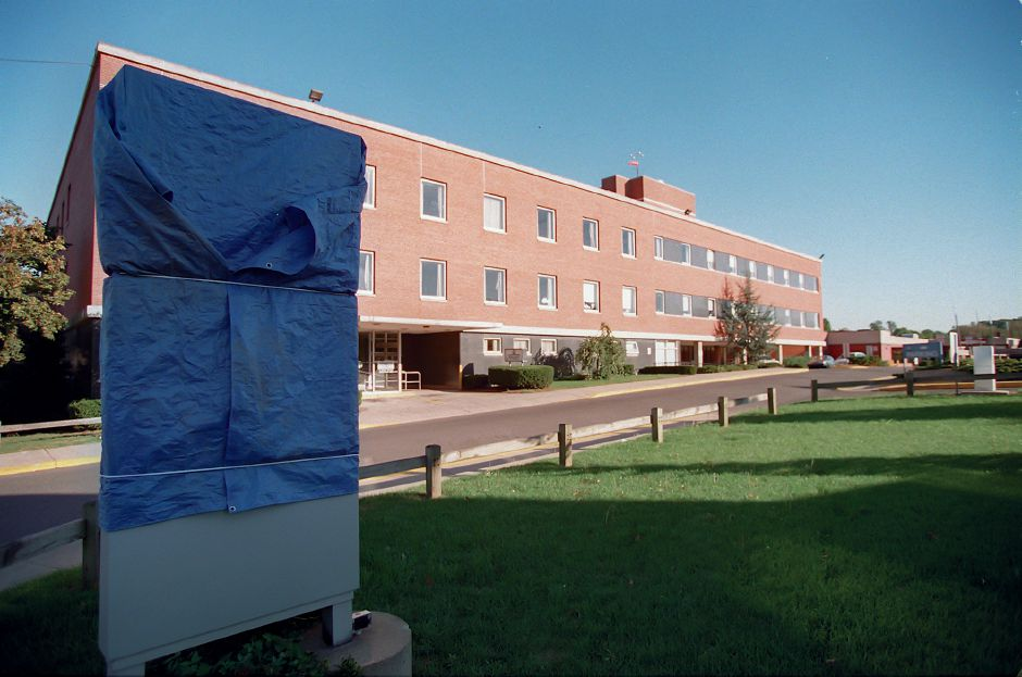RJ file photo - The sign at Veterans Memorial Medical Center on Cook Avenue is wrapped in a blue tarp, letting people know the hospital is no longer in operation, Sept. 29, 1998.