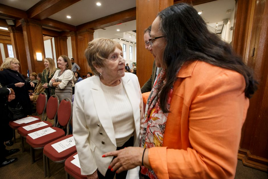 Inductee Amelia Mustone left is congratulated by State Representative Hilda Santiago Sunday during the 42nd Meriden Hall of Fame induction ceremony at the Curtis Cultural Center in Meriden October 21, 2018 | Justin Weekes / Special to the Record-Journal