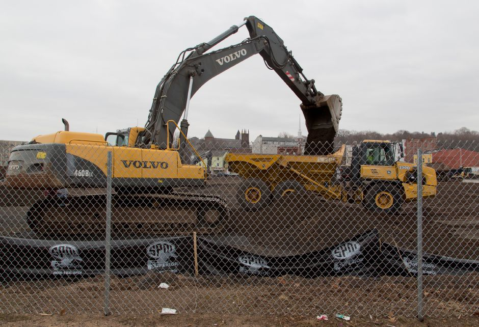 A excavator from LaRosa Construction loads top soil into a dump truck at the former Hub site in downtown Meriden, March 28, 2014. | Christopher Zajac / Record-Journal