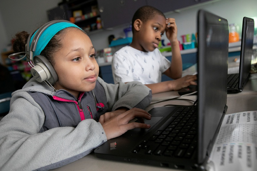 Lunary Vega, 8, left, and Dominique Brown, 8,  work on laptops in their third-grade class at John Barry  School in Meriden on Wednesday. The school system was recently recognized by a national education organization for its digital technology efforts.