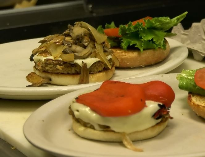 Philly and Italian style veggie burgers prepared at Paul