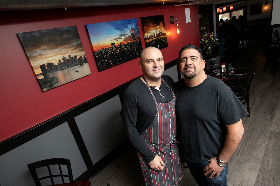 Owners Michael Migliaro, left, and Stephen Barraco pose in the dining room at Amici Tavern, 43 Broadway, North Haven, Wed. Feb. 6, 2019. Dave Zajac, Record-Journal