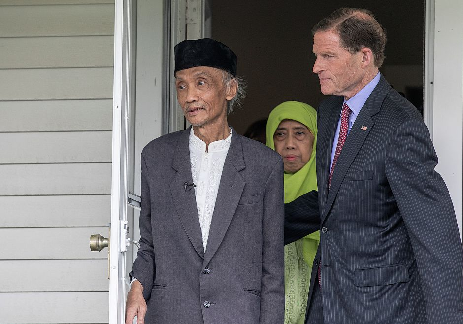 "Sujitno Sajuti and wife Dhalia of West Hartford walk out of the Unitarian Universalist Church in Meriden with Senator Richard Blumenthal, Fri., May 31, 2019. Sajuti entered sanctuary at the Meriden Unitarian-Universalist Church on October 9, 2017, under threat of deportation by Immigration and Customs Enforcement (ICE). Last Friday U.S. Citizenship and Immigration Services ""granted Sajuti deferred action, based on his demonstrated eligibility for a U Visa, a type of relief for survivors of certain crimes,"" the release stated. Dave Zajac, Record-Journal"
