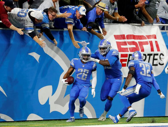 Detroit Lions cornerback Quandre Diggs (28) celebrates his interception for a touchdown of a New York Jets quarterback Sam Darnold pass in the first quarter of an NFL football game in Detroit, Monday, Sept. 10, 2018. (AP Photo/Rick Osentoski)