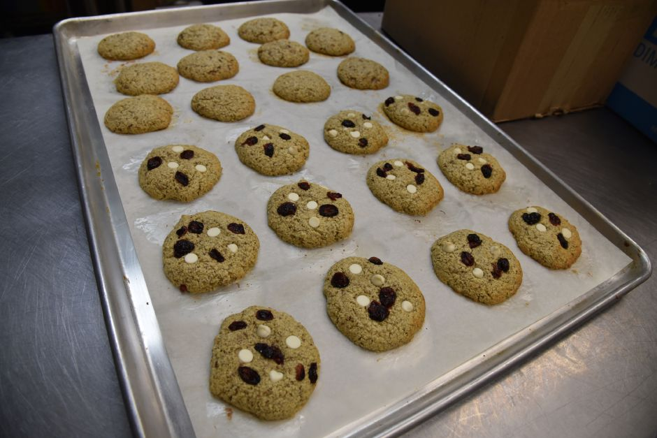 A batch of toffee crunch and cranberry white chocolate protein cookies inside the kitchen of Moon Rocks Gourmet Cookies in Hamden on Jan. 18, 2018. | Matthew Zabierek, Record-Journal